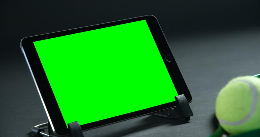 Close-up of tennis balls, racket and digital tablet in studio 4k | Shutterstock HD Video #30697450