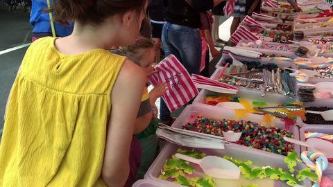 Busy market sweet stall with variety of pick and mix candy