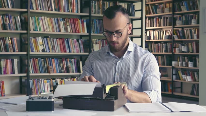 Writing man typing on a typewriter