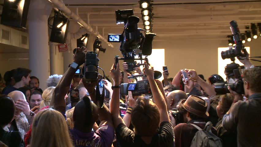 NEW YORK - SEPTEMBER 11: Photographers crowd shooting celebrities before the runway at the Blonds Collection for Spring/ Summer 2013 during Mercedes-Benz NY Fashion Week on September 11, 2012 in NYC