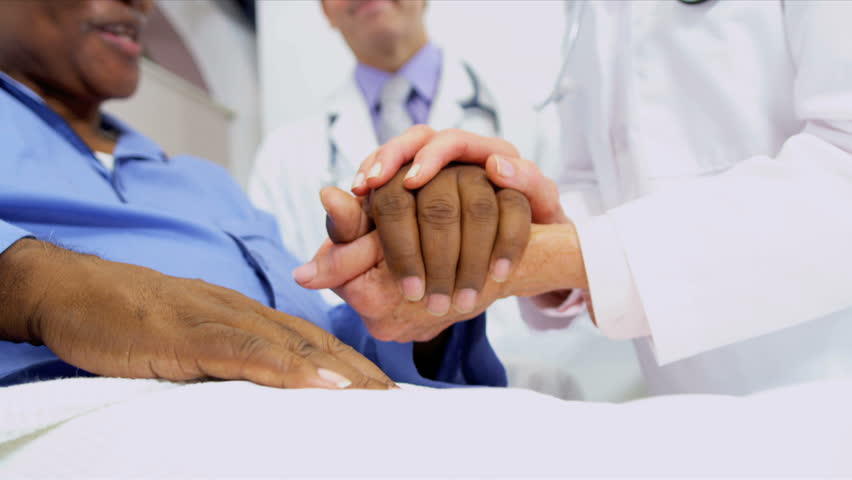 Medical Consultants Reassuring Patient | Shutterstock HD Video #3075292