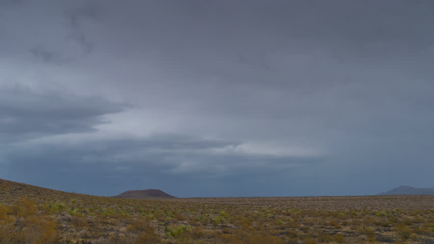 Thunderstorm Mojave Desert with Distant mountains 4K from 6K source | Shutterstock HD Video #30764308