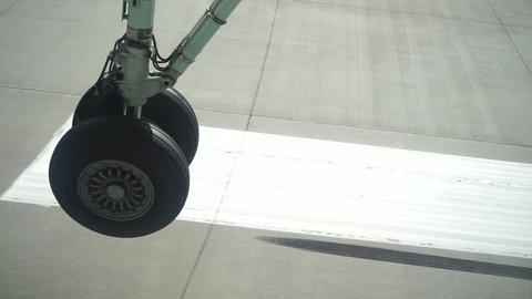 Airplane landing passenger view on wheel
