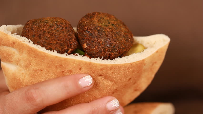 Female chef's hands cook Falafel or felafel deep-fried ball made from ground chickpeas Tahini Middle East