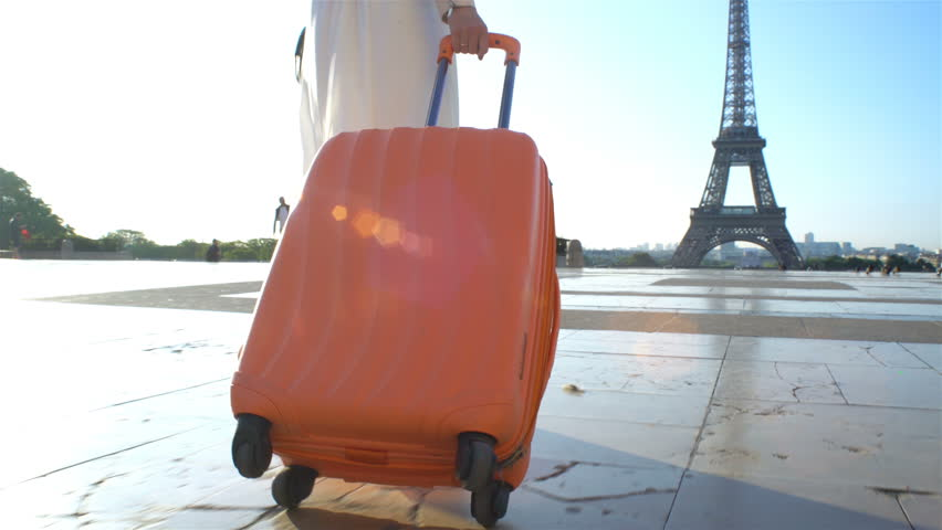 Young Woman with the Orange Suitcase Traveling to Paris. Eiffel Tower Background. | Shutterstock HD Video #30867796