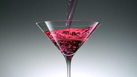 Pouring cocktail into martini glass shooting with high speed camera, phantom flex.