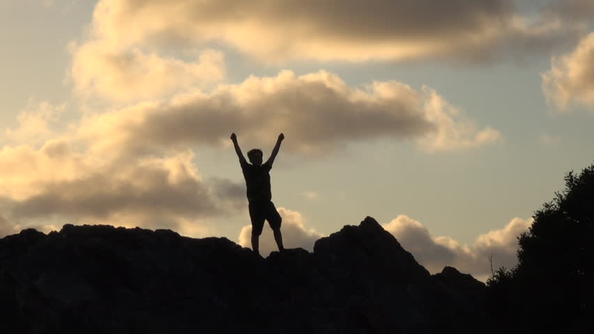Silhouette of boy with open arms at sunset #30888742
