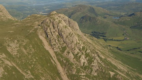 Aerial footage passing behind the summit of Pike o Stickle, Langdale, Lake District.
