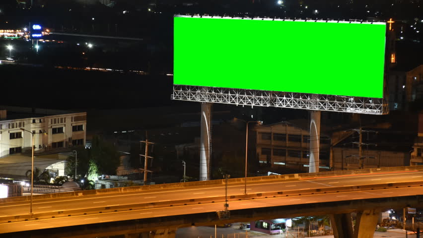 Time lapse traffic with green screen billboard in the city at night | Shutterstock HD Video #30940264