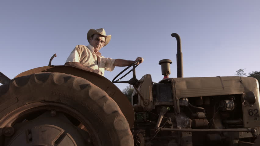 59.94fps (It can be in slow motion) happy farmer with a hat driving tractor #30953134