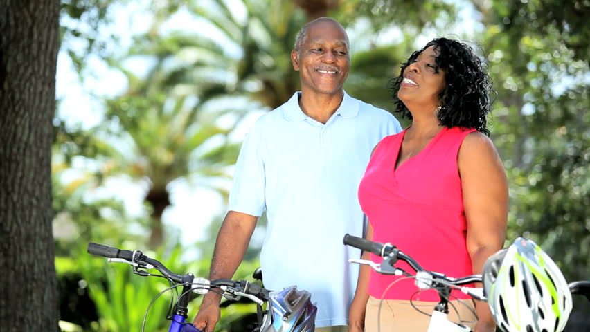 Mature diverse couple getting ready for cycling | Shutterstock HD Video #3095992