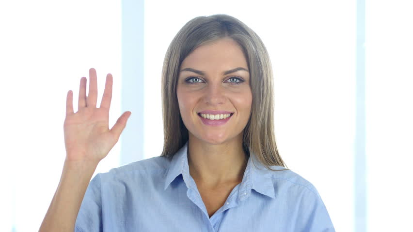 Portrait of Beautiful Young Woman Waving Hand to Welcome | Shutterstock HD Video #30968632