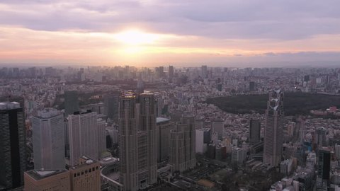 Japan Tokyo Aerial v115 Flying over Shinjuku area with cityscape views at sunrise