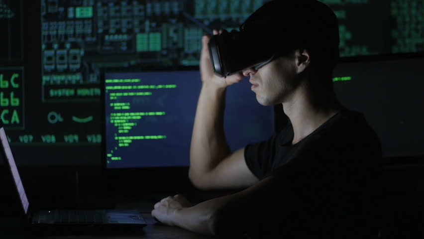 Male hacker programmer uses a virtual reality helmet for programming. IT Technologies of the Future. | Shutterstock HD Video #31015642