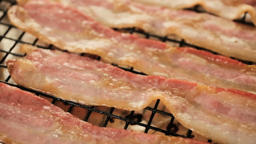 Cooked bacon strips on a baking sheet. | Shutterstock HD Video #31017172