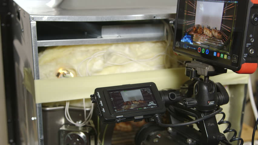 MOSCOW, RUSSIA - CIRCA AUGUST 2017: Behind the scenes, video recording studio setup food preparation inside electric oven. Sony PXW-FS7 XDCAM Super 35 camera and Atomos Ninja Flame HDMI monitor   Shutterstock HD Video #31028209