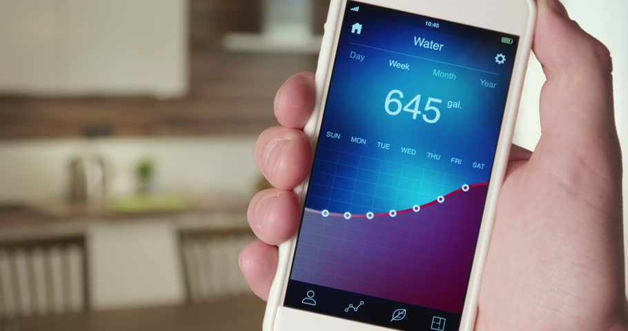 Monitoring water consumption levels in the house using smartphone app | Shutterstock HD Video #31029232