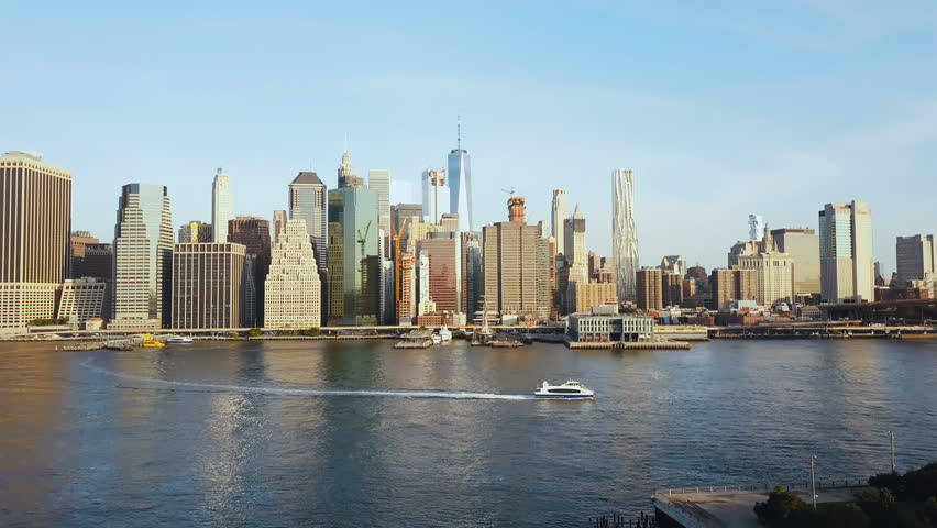 Aerial view of famous city, New York, America. Drone flying over the East river with boat riding through and Manhattan. | Shutterstock HD Video #31030684