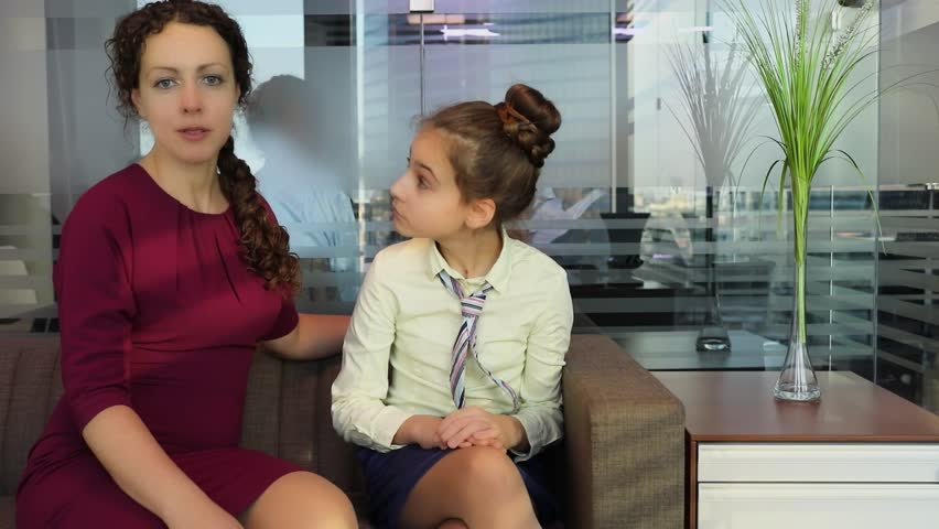 Woman and teenage girl talk on sofa during meeting in modern office | Shutterstock HD Video #31037842