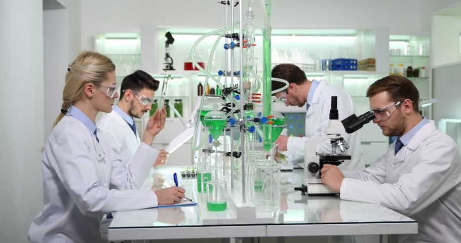 Team Of Experts Biochemists Conversation Research Laboratory Work On