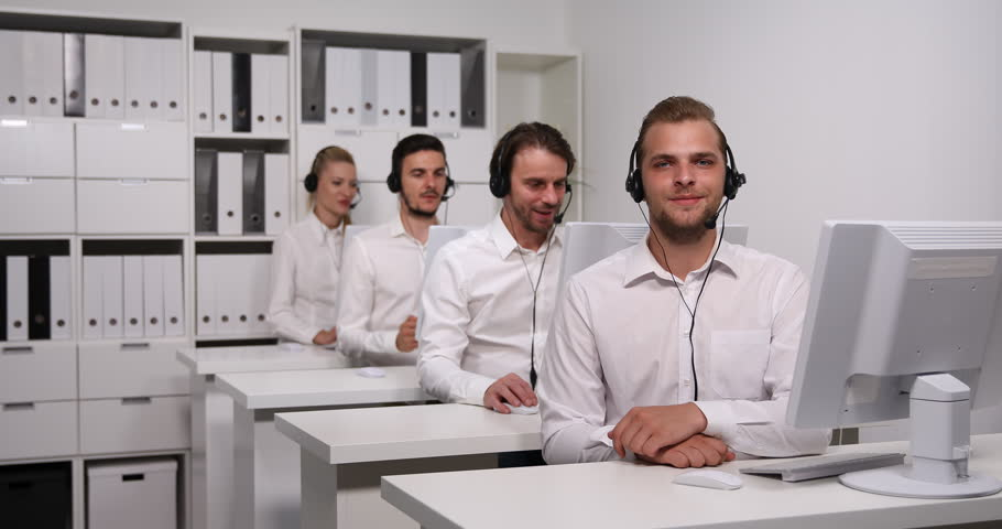 Business People Presentation Call Center Team Young Agents Posing Looking Camera | Shutterstock HD Video #31057912