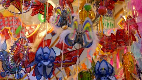 Traditional culture on mid autumn in lunar year, local people sell lanterns on Luong Nhu Hoc street. People visit, buy lantern, take photo with colorful lanterns. On lanterns not brand name or logo