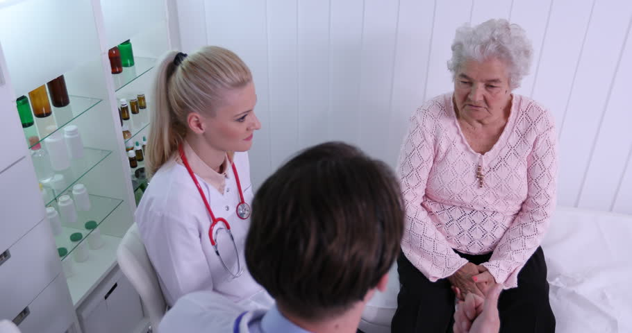 Team of Medical Doctors Discussing with Old Woman Patient Hospital Cabinet Room | Shutterstock HD Video #31082032