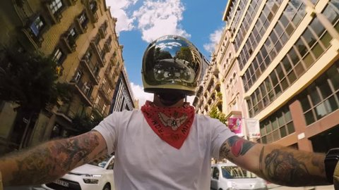 1f6f8d632 Cool confident hipster brutal man with arm tattoos sleeves rides motorbike  in vintage retro protective helmet