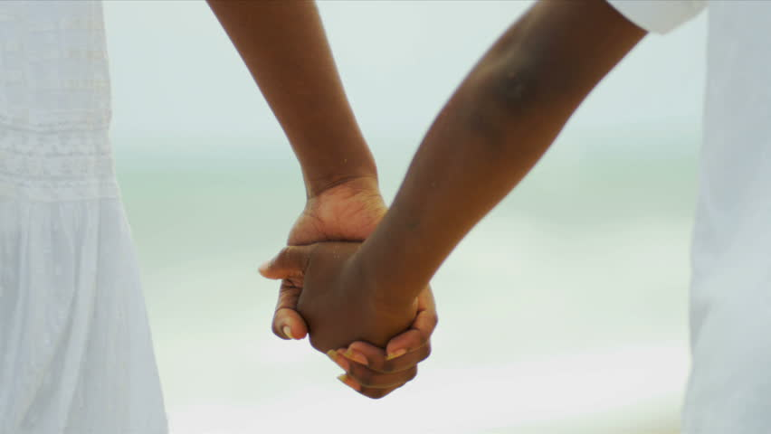 Close up of African American siblings holding hands