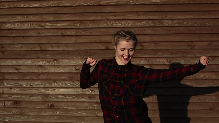 Blonde girl enjoys dancing on wooden background   Shutterstock HD Video #31096042