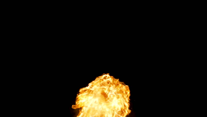 Almost like a fountain of flame, rolling bursts of fire rush upwards in slow motion against black.