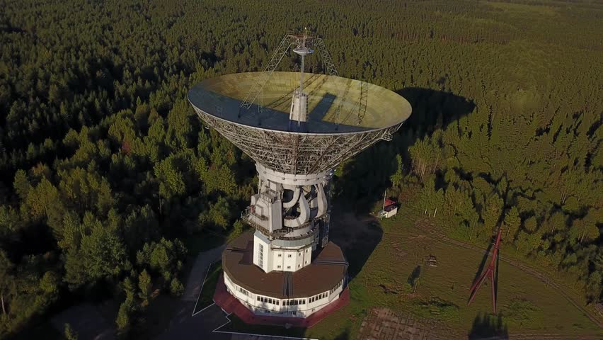 4K high quality aerial drone video of observatory's parabolic reflector 64 m in diameter radio telescope in forest near Tolstouhovo village, town Kalyazin 200 km north of Moscow, Russia on summer day   Shutterstock HD Video #31115722