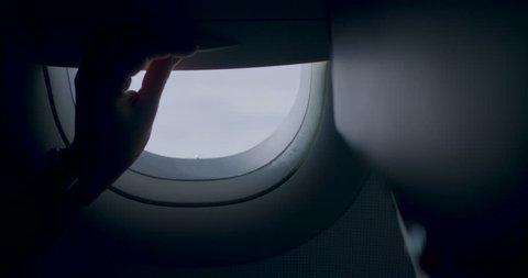 Opening the airplane window, pothole