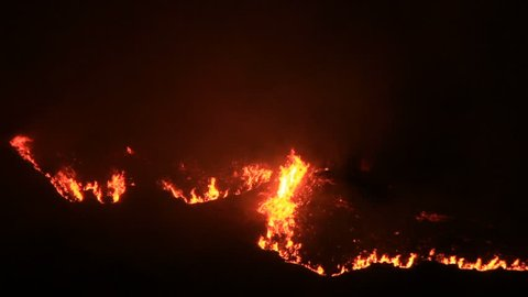 Giant wildfire burns at night