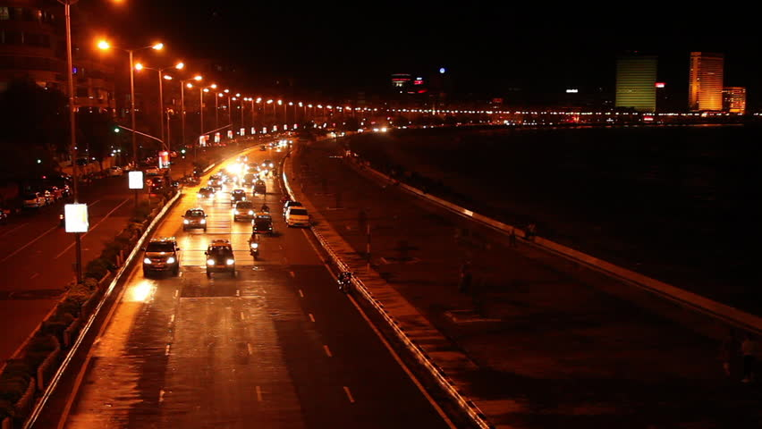Time lapse shot of a city lit up at night, Marine Drive, Mumbai, Maharashtra, India