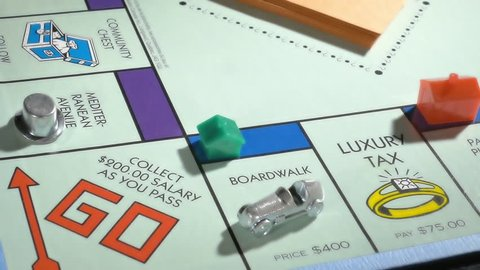 BOSTON, MA - SEPT 27: Playing Monopoly board game on September 27, 2017. Monopoly has become a part of popular world culture, having been locally licensed in more than 103 countries.