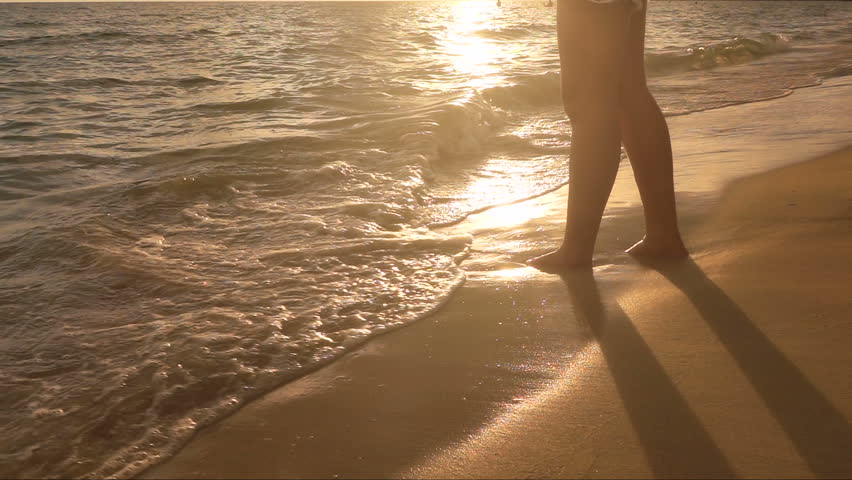 Slow notion : Woman leg at Sunset Beach with little sea wave  | Shutterstock HD Video #31156132