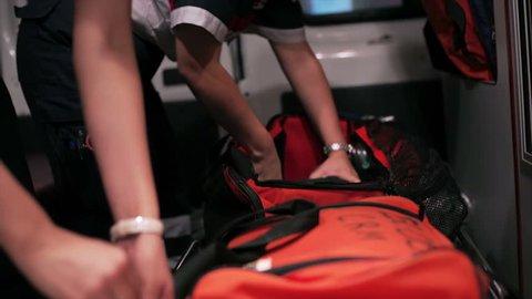 Paramedics checks the medical equipment of the ambulance