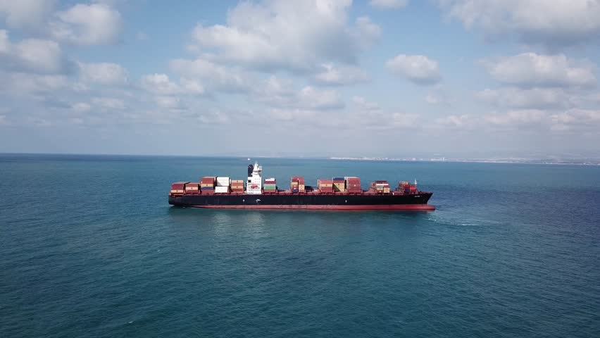 Haifa, Israel - 26 Sep, 2017: The MSC container ship is entering the port loaded with containers and cargo - aerial 4k view