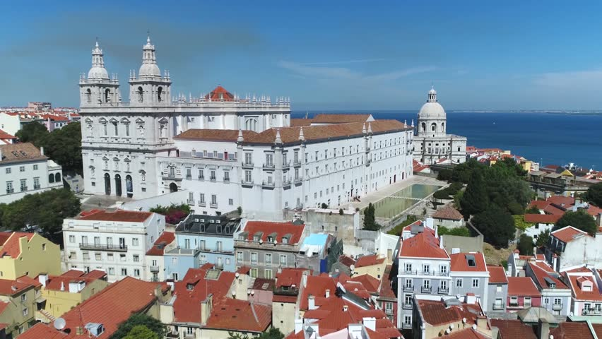 Aerial view of Church or Monastery of Sao Vicente de Fora in Portuguese Igreja da Sao Vicente de Fora a 17th-century church and monastery in the city of Lisbon Portugal flying backwards slowly 4k | Shutterstock HD Video #31224652