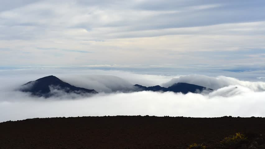 Mountain draped in clouds at haleakala national park maui hawaii mountain draped in clouds at haleakala national park maui hawaii stock footage video 3125782 shutterstock publicscrutiny Image collections