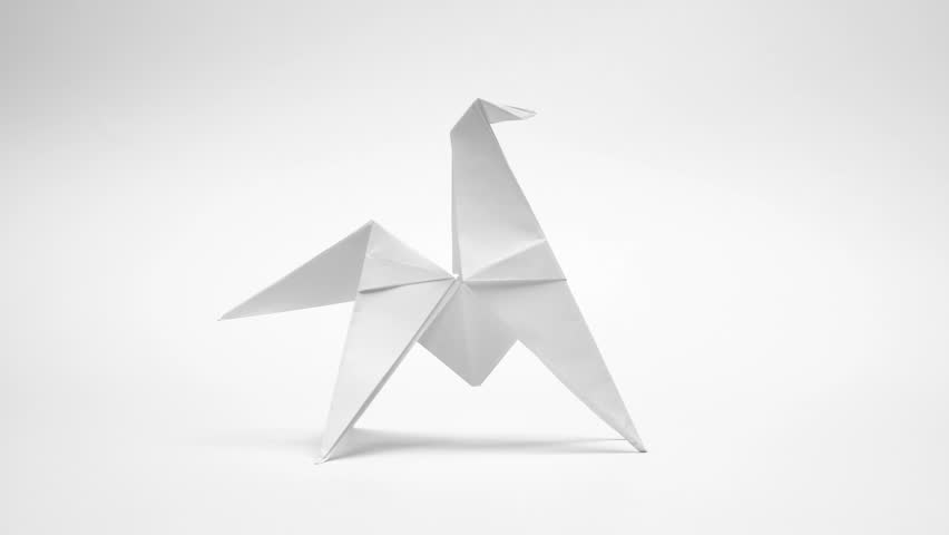 Origami animals made from blank paper. 4k stop motion animation.