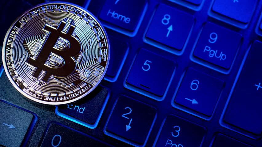 Golden Bitcoin Coin on computer keyboard. Close-up.    Shutterstock HD Video #31316962