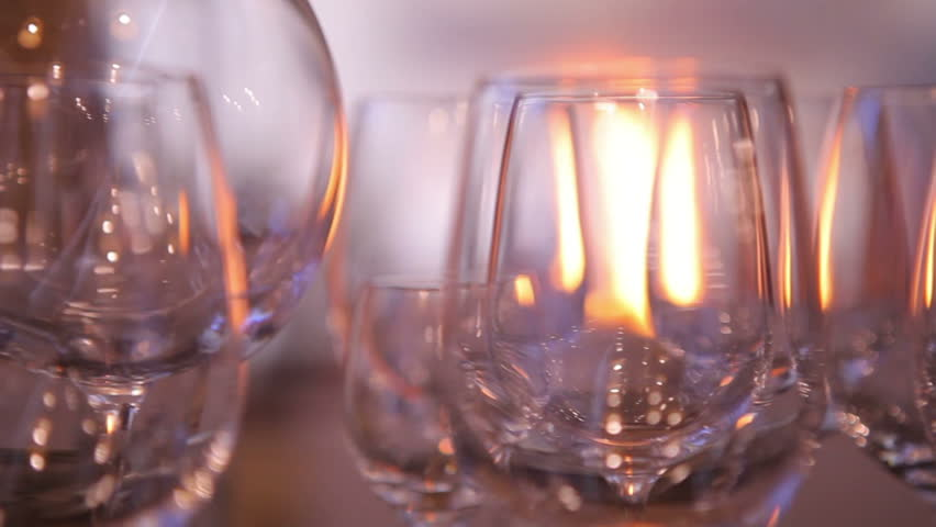 Fireside with different empty glasses for a wine drying in the bar. Christmass mood. Close up | Shutterstock HD Video #31318462