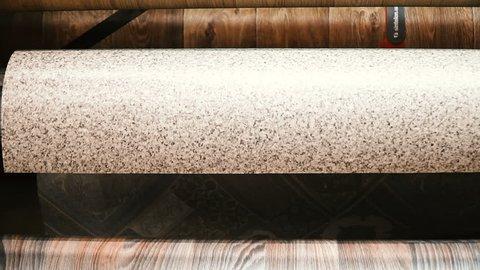 Linoleum. Rolls of linoleum in the shop window