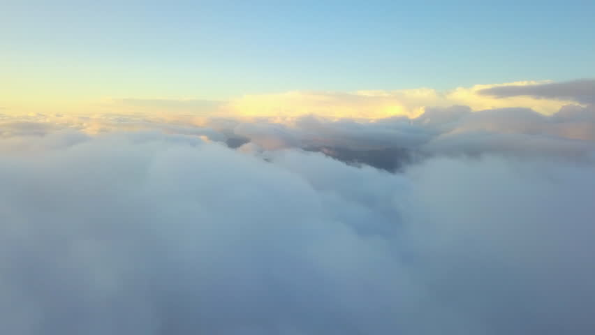 Aerial drone view: flying in clouds. Beautiful sunset in the clouds. Above mountains. Amazing nature landscape. Concept: flying, airlines, afterlife, god, religion, organic clouds  | Shutterstock HD Video #31369594