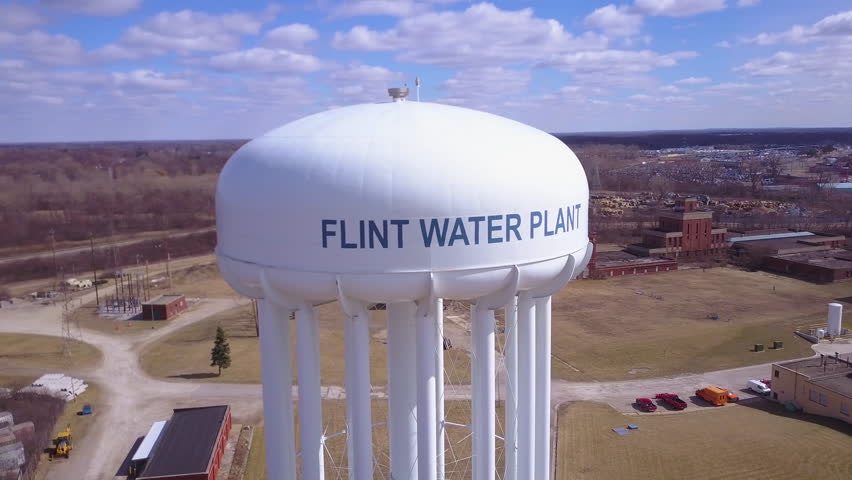 CIRCA 2010s - Flint, Michigan - Aerial over the Flint Michigan water tanks during the infamous Flint water crisis.