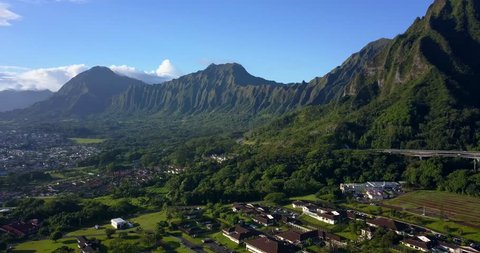 Amazing aerial footage view of the mountains by the famous Haiku stairs and stairs to Heaven hike. The living district next to the trail. Amazing Hawaii.