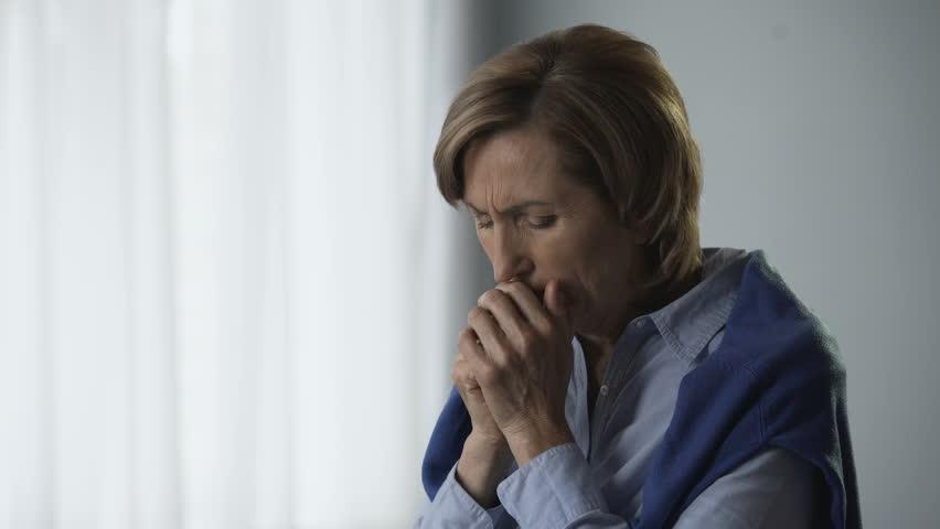 Senior woman getting extremely worried, feeling emotional experience, motherhood