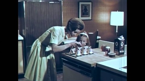 CIRCA 1960s - A 1960s housewife demonstrates how to use the new kitchen appliances.